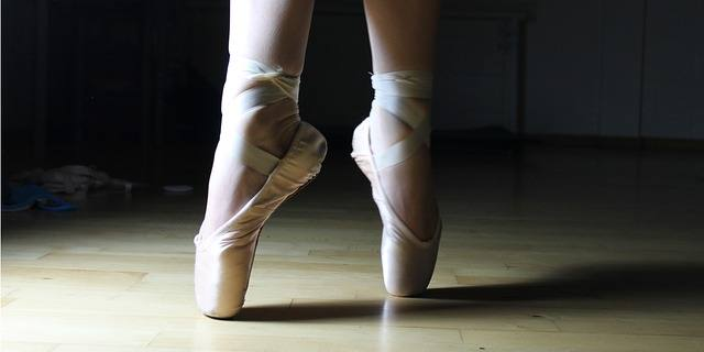 sewing ribbons on pointe shoes